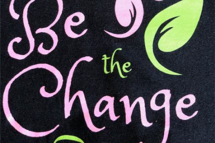 Be the Change Logo on Black Shirt