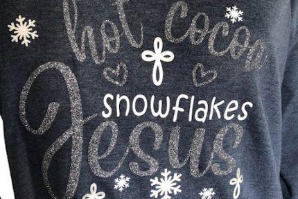 hor cocoa snowflakes jesus navy long sleeve hoodie